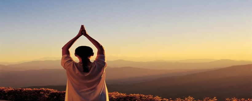 Early morning Yoga by mountains