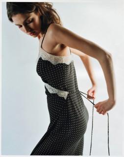 Girl putting on dress