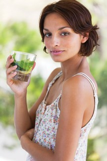 Woman holding a cup of herbal tea